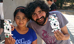 Mira Verma and Stanford bioengineer Manu Prakash hold the Foldscope, a foldable microscope