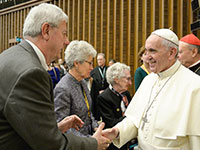 NCATS' Dr. Stephen Groft (left) shakes hands with Pope Francis.