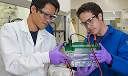 "Cheng-ting ""Jason"" Tsai and Peter Robinson prepare a gel electrophoreresis experiment to analyze a DNA-tagged biomarker"