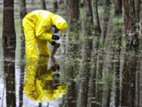 Researcher collects samples for toxicity testing