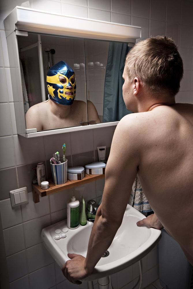 man in mask at mirror