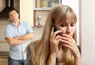 woman in infidelity on the phone