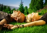 Couples tantric touching on the grass