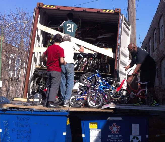 WB board members loading bikes in container