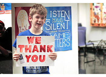 Picture of STARS student holding up thank you sign