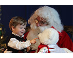 Picture of BEGIN child on Santa's lap
