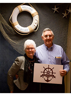Picture of couple holding sign that says I cruised with CVI