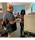 Picture of CVI client testing voting machine