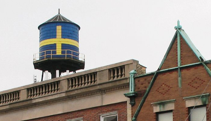 The much loved former water tower in Andersonville, painted with the Swedish Flag ipeeks out behind rooftops
