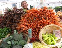 Farmer Adam & and huge pile of carrots