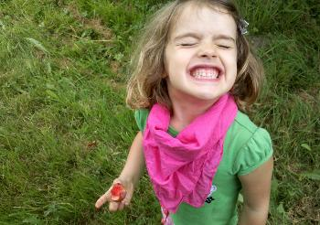 A happy camper eating a plum
