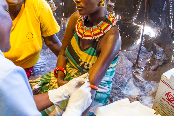 A woman in Barsaloi receives a contraceptive implant