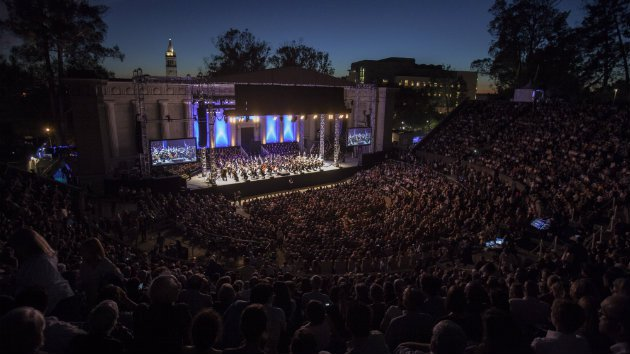 Photograph at night of the performance at the Greek Theatre for Cal Performance's presentation of Beethoven's 9th Symphony with Gustavo Dudamel, the Simon Bolivar Symphony Orchestra of Venezuela, the San Francisco Girls Chorus, the Pacific Boychoir Academy, and the UC Berkeley Chamber Choir