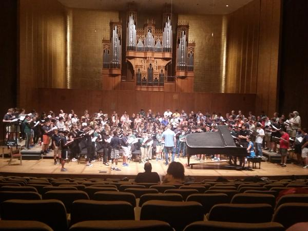 Combined choruses rehearsing Beethoven's 9th Symphony at Cal Performances