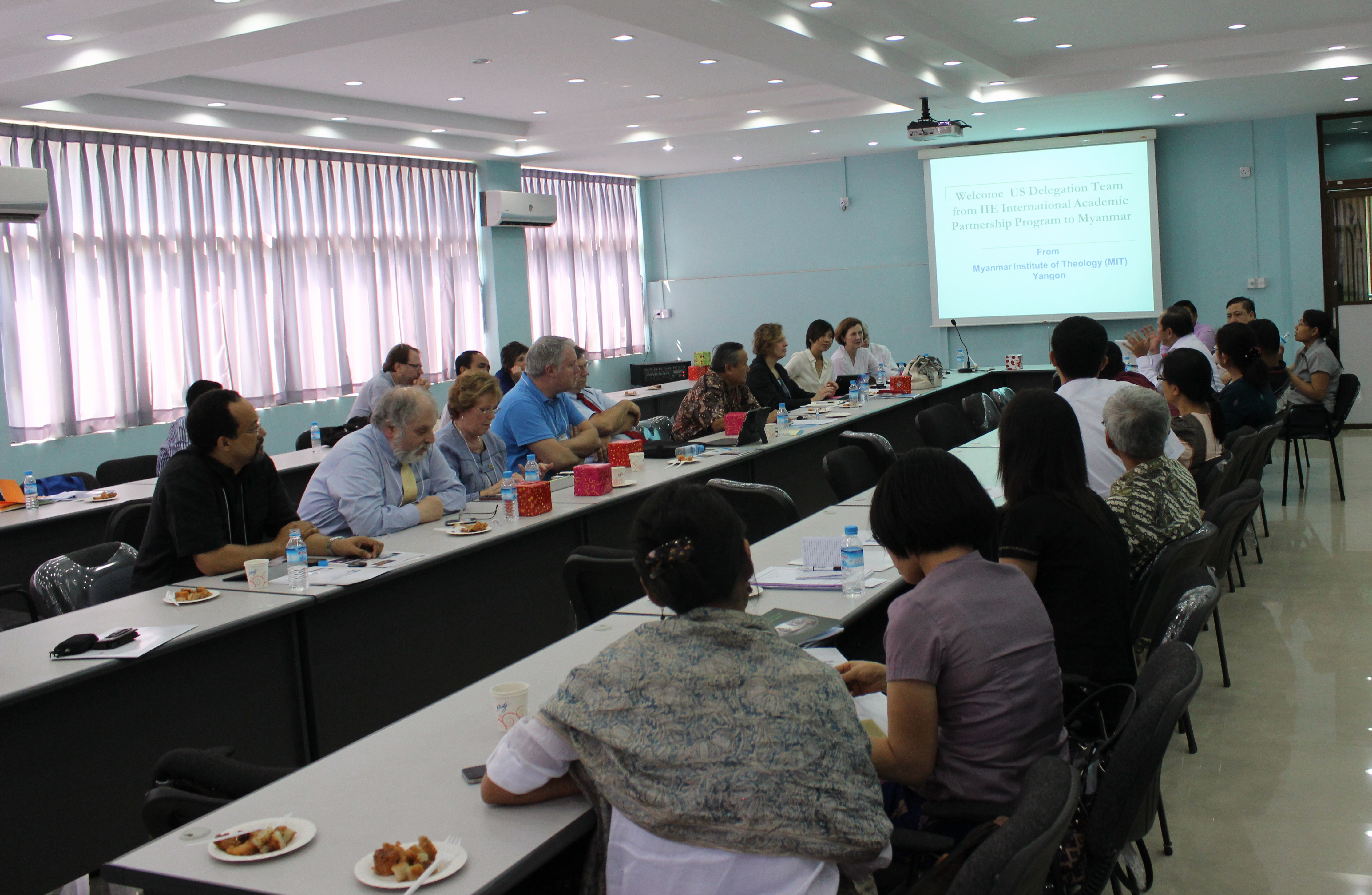 Dr. Cogburn presents during Myanmar visit in March 2013 (photo)