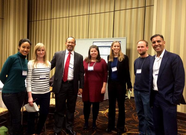 Dr. Cogburn and ISA 2014 Junior Scholar Symposium participants (photo)