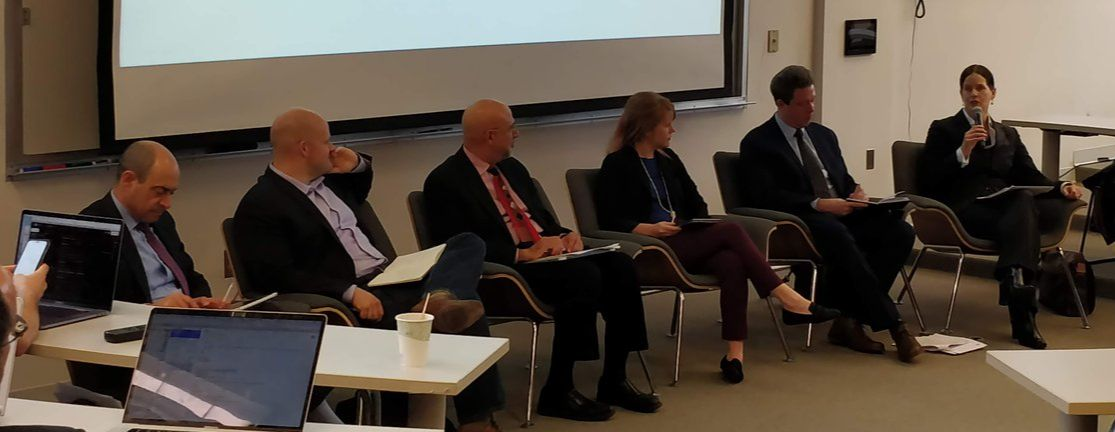 Image of panelists during a recent discussion on curbing government hacking of civilians.