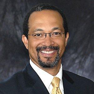 Dr. Derrick L. Cogburn (photo)