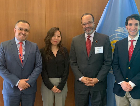 Dr. Cogburn, Dr. Alex Camacho (PAHO), and two M.S. Analytics Students