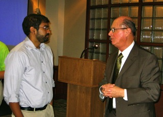 Dr. Shingavi talking with Dr. Charles Roeckle from the Office of the President