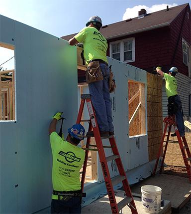 Laborers constructing wall