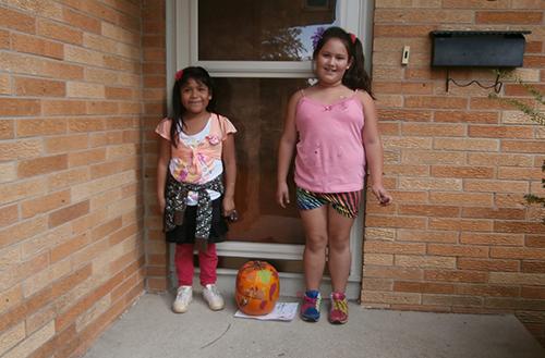 Elementary school students deliver pumpkins