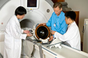 Drs. Yeuxi Huang, Kullervo Hynynen and Junho Song assemble a magnetic resonance imaging (MRI)-guided focused ultrasound device, developed by Sunnybrook Research Institute. Photo by Doug Nicholson, Sunnybrook Health Sciences Centre.