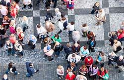 aerial view of crowd on city sidewalk