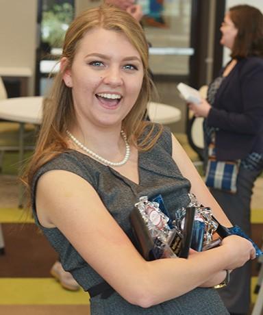 Kelsie Watkins smiles for a photo