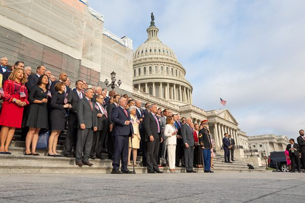 Members of Congress sing God Bless America at the Capitol
