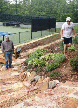 """Several Garden Club volunteers enjoying the beautiful weather and sprucing up our new """"Woodlands"""" Park"""