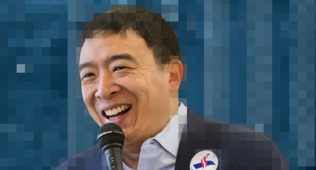 Pixelated image of Andrew Yang smiling in front of a microphone