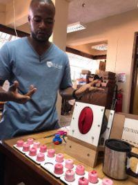 A man demonstrates cervical models