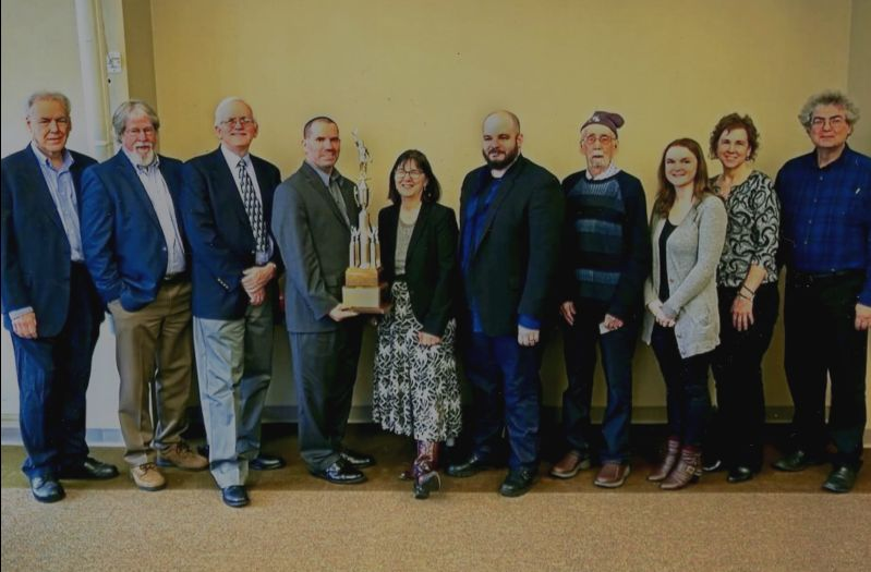 Past – and present – recipients of the Frederick L. Ferris Award pose with the award (held by yours truly) at Rider University on Dec. 15, 2018. The award, which debuted in 1957, is named for Rider's first journalism professor and honors a graduating senior for excellence in journalism. (Photo by Martin Griff)