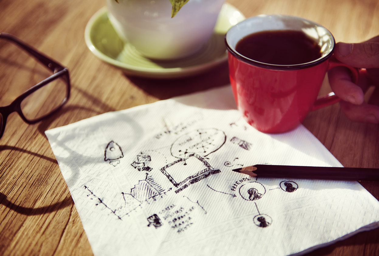 picture of a pencil and a napkin and a cup of coffee