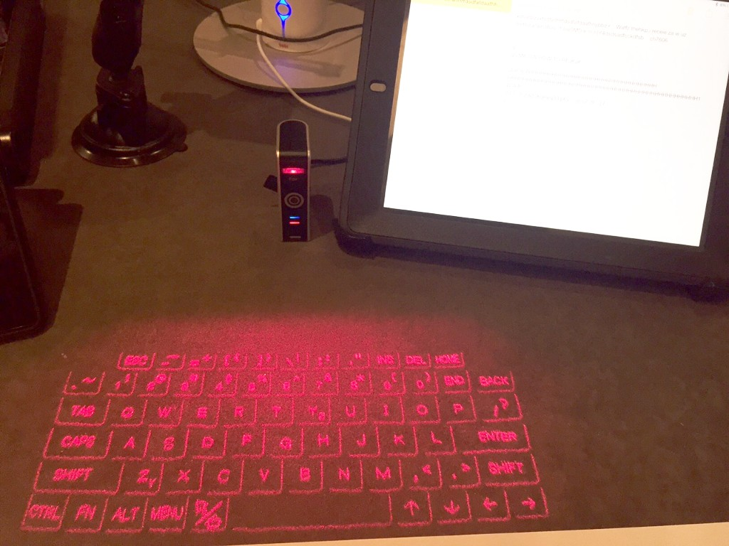 iPad with keyboard projected on table top.