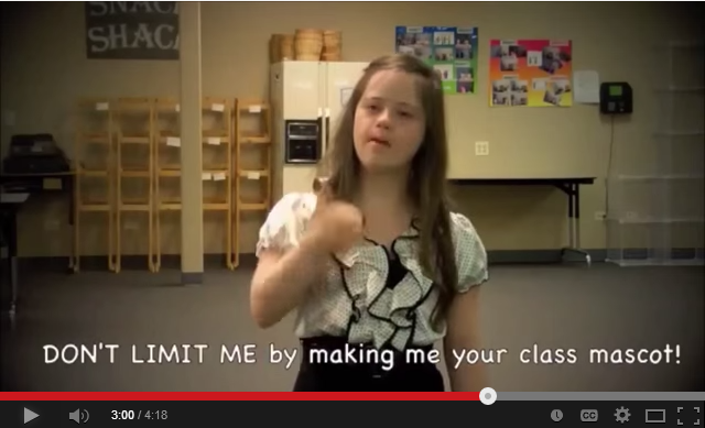 """YouTube screen shot shows young girl with Down Syndrome gesturing with caption that reads, """"Don't limit me by making me your class mascot."""""""