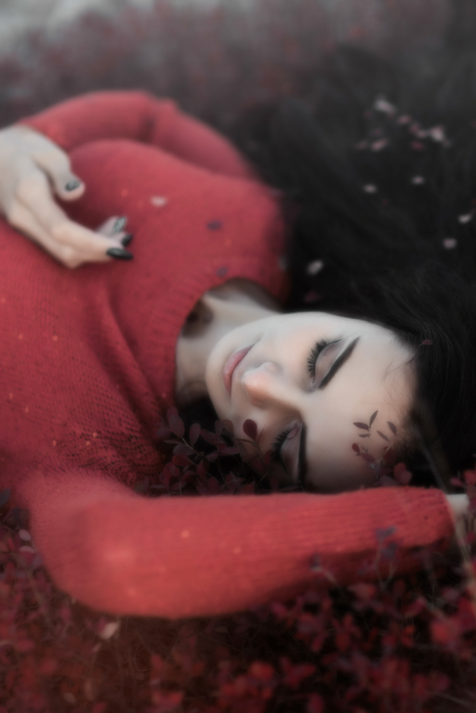 Woman in red, sleeping