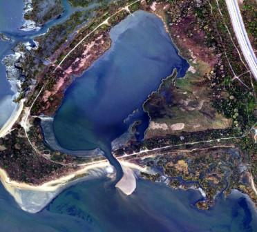 The breach in Jamaica Bay Wildlife Refuge's West Pond is visible above. © NOAA