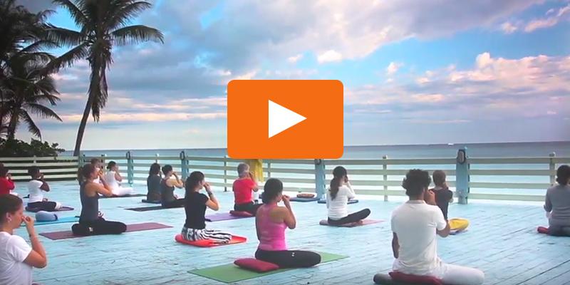 yoga class on beach platform