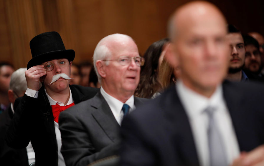 Photo: An activist dressed as the Monopoly Man.