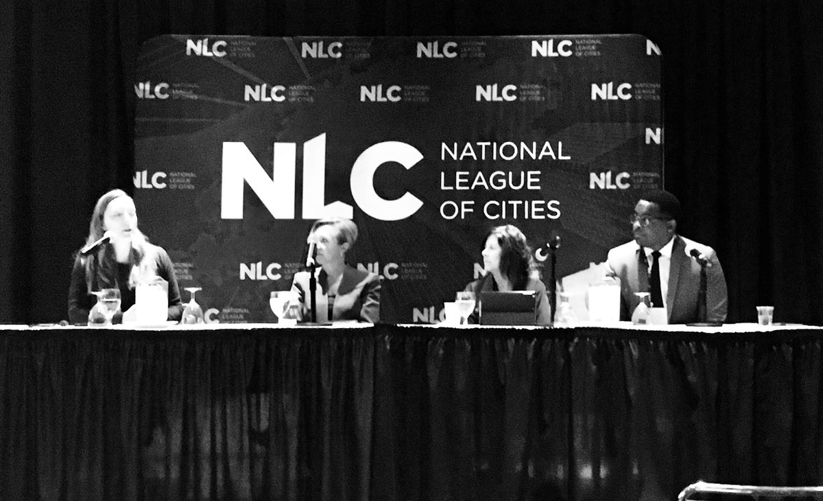 Photo: Stacy Mitchell moderates panel at National League of Cities event.