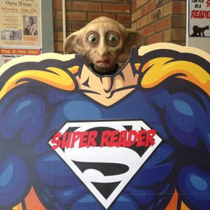 Dobby statue as a super reader.