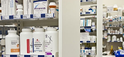 Shelves at pharmacy with pill bottles