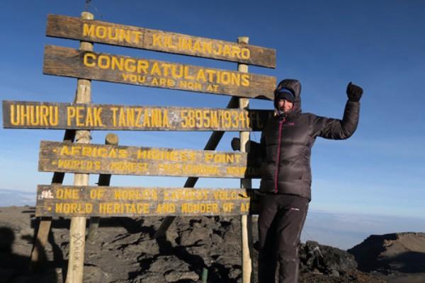 Helen Cox at the summit of Kilimanjaro. © Helen Cox