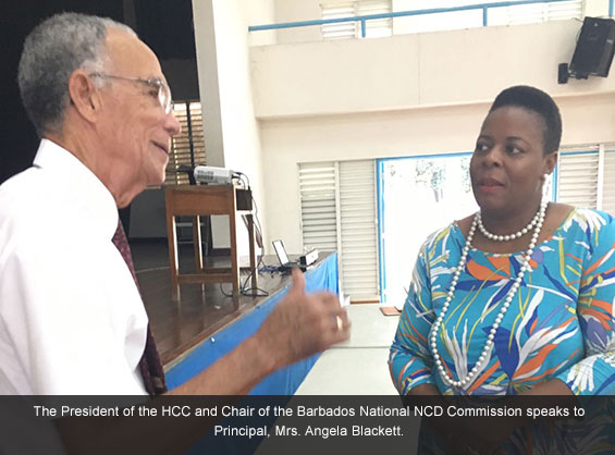 The President of the HCC and Chair of the Barbados National NCD Commission speaks to Principal of Saint Gabriel's, Mrs. Angela Blackett.