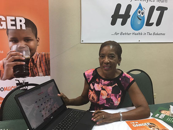 Mrs Patricia Minnis, wife of the Prime Minister of the Bahamas signing