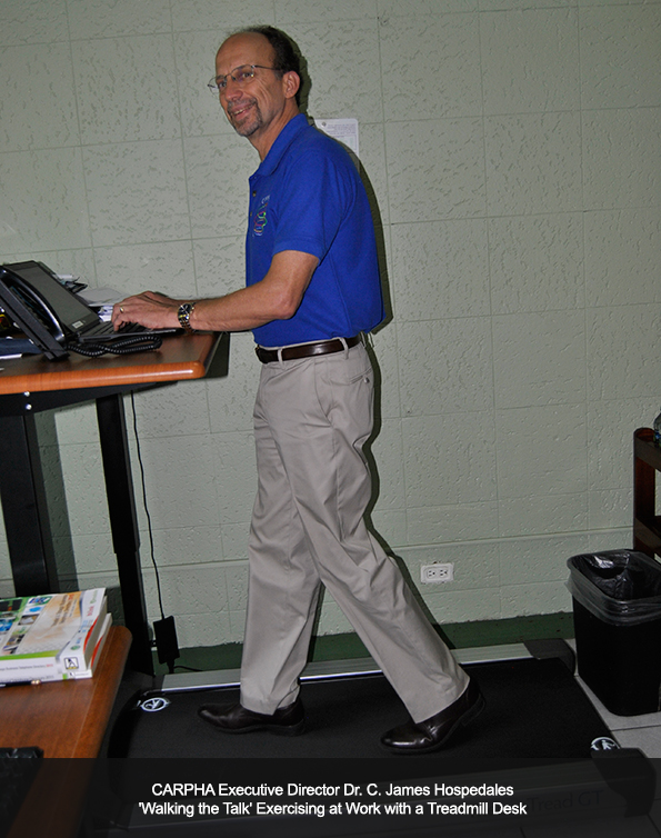 CARPHA Executive Director 'Walking the Talk' Exercising at Work with a Treadmill Desk