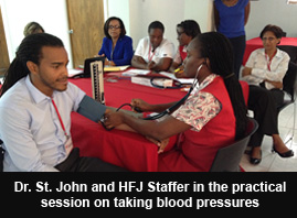 Dr. St. John and HFJ Staffer in the practical session on taking blood pressures