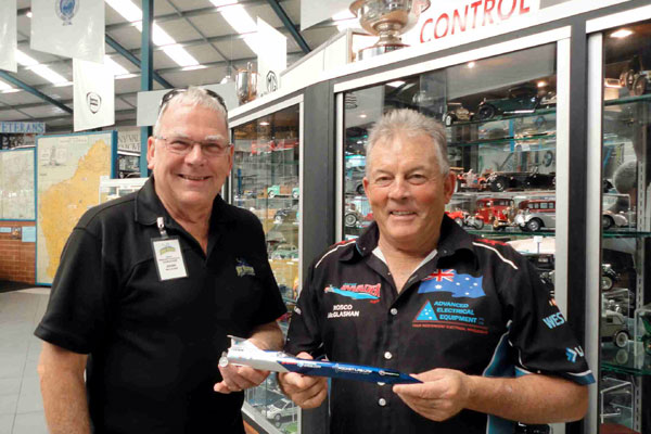 Rosco presents Aussie Invader 5R model to the museum curator John McLean